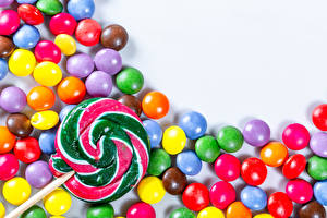 Pictures Confectionery Candy Dragee Lollipop White background Multicolor