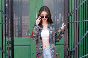 Photo Asian Pose Hands Jacket Eyeglasses Glance Brown haired Beautiful Camouflage female