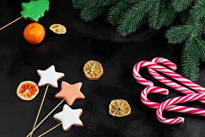Fotos Neujahr Kekse Dauerlutscher Mandarine Ast Stern-Dekoration Lebensmittel