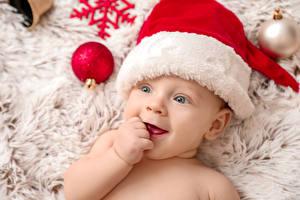 Bilder Neujahr Säugling Mütze Lächeln Kugeln kind