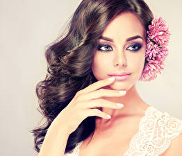 Pictures Colored background Brunette girl Face Hands Staring Hair Makeup