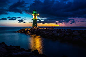 Hintergrundbilder Deutschland Leuchtturm Steine Meer Abend Rostock Natur