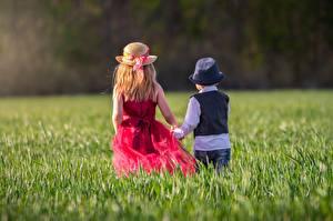 Wallpapers Grass Two Hat Little girls Boys Back view Children