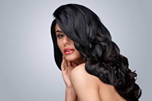 Photo Gray background Brunette girl Hair Glance Hairstyle female