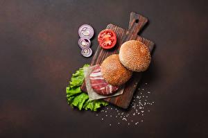 Fotos Burger Brötchen Fleischwaren Gemüse Schneidebrett