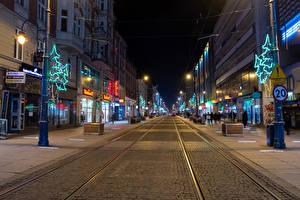Image Poland New year Building Roads Street Fairy lights New Year tree Night time Katowice Cities