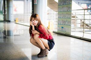 Bilder Asiaten Bokeh Pose Bein Braune Haare Nett Blick junge frau