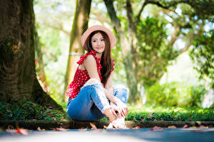 Pictures Asiatic Bokeh Sit Jeans Blouse Hat Brown haired Sweet Girls