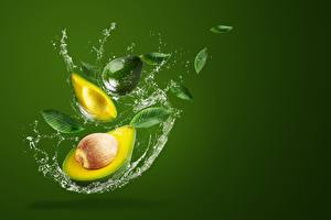 Pictures Avocado Colored background Water splash
