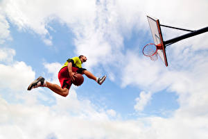 Pictures Basketball Man Ball Jump Legs Bottom view athletic