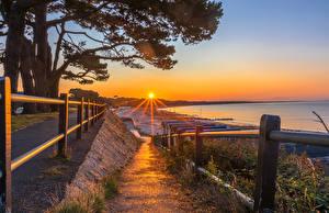 Hintergrundbilder England Sonnenaufgänge und Sonnenuntergänge Küste Sonne Zaun Bäume Mudeford Christchurch District Natur
