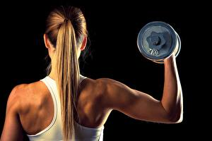 Wallpapers Fitness Back view Dumbbell Human back Blonde girl Hair Black background young woman