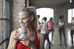 Images Fitness Blonde girl Mug Smile young woman