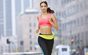 Pictures Fitness Run Hands Glance Bokeh Brunette girl female