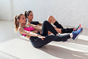 Pictures Fitness Workout Two Uniform Brown haired Hands Legs young woman