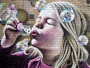 Images Graffiti Soap bubbles Little girls Face Wall Made of bricks Children