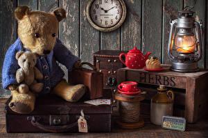 Wallpapers Still-life Clock Kerosene lamp Teddy bear Kettle Little cakes Wall Cup Suitcase Food