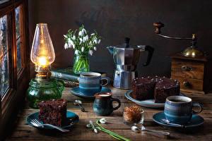 Pictures Still-life Kerosene lamp Snowdrops Kettle Torte Coffee Pieces Mug Food