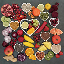 Picture Vegetables Fruit Nuts Orange fruit Apples Raspberry Mandarine Tomatoes Onion Chili pepper Plums Gray background Heart Food