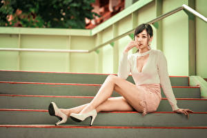 Image Asiatic Stairway Sit High heels Legs Skirt Blouse Brown haired Staring young woman