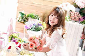 Wallpapers Bouquets Asian Smile Sweet Brown haired Glance female Flowers