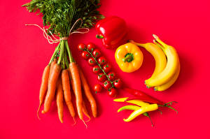 Pictures Carrots Tomatoes Bell pepper Chili pepper Bananas Red background