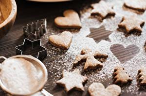 Fotos Kekse Puderzucker Engeln Herz Kleine Sterne Fichten das Essen