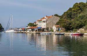 Bilder Kroatien Küste Haus Seebrücke Boot Motorboot Pomena Mljet Städte