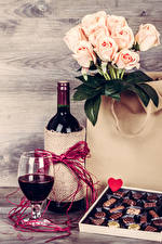 Pictures Holidays Still-life Roses Wine Candy Boards Bottle Stemware Heart Food Flowers