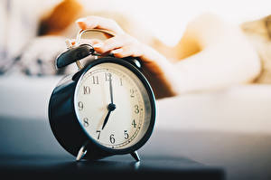Image Morning Clock Clock face Alarm clock Closeup Hands Blurred background 7:00