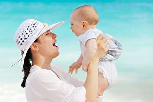 Image Mother Baby Happy Hands Hat young woman