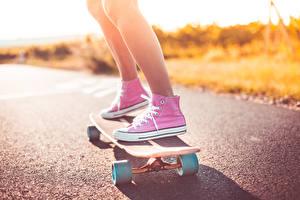 Image Skateboard Closeup Legs Plimsoll shoe Asphalt