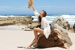 Image Stones Sea Summer Sand Sitting Legs Hat Happy Relax Brown haired young woman