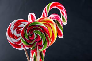 Hintergrundbilder Süßigkeiten Dauerlutscher Großansicht Grauer Hintergrund Lebensmittel