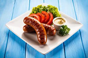 Desktop hintergrundbilder Frankfurter Würstel Gemüse Teller Senf das Essen