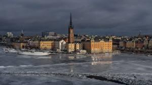 Bilder Winter Gebäude Fluss Stockholm Schweden