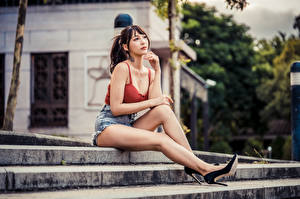 Photo Asiatic Sit High heels Legs Shorts Sleeveless shirt Brown haired young woman