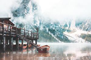Desktop wallpapers Boats Lake Mountain Italy Fog Lake Braies Nature