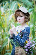 Pictures Bouquet Asiatic Blurred background Frock Hands Brown haired Hat Staring Lovely
