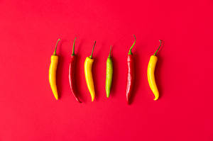 Picture Chili pepper Red background