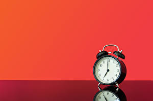 Pictures Clock Alarm clock Reflected Red background