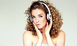 Images Curls Gray background Hands Face Brown haired Headphones Staring Surprised