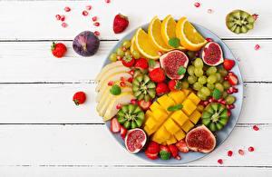 Bilder Obst Kiwifrucht Weintraube Apfelsine Echte Feige Mango Geschnittene Bretter das Essen