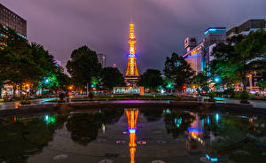 Picture Japan Houses Pond Night time Town square Rays of light Sapporo Cities
