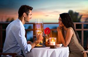 Pictures Asiatic Man Candles Table Smile On a date young woman