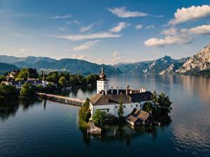Bilder Österreich See Himmel Berg Kirchengebäude Wolke Alpen Traunsee Natur