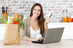 Pictures Laptops Paper bag Purchase Smile Brown haired Staring Girls