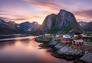 Картинка Гора Рассвет и закат Лофотенские острова Норвегия Здания Природа