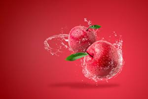 Photo Apples Water splash Red background Red Food