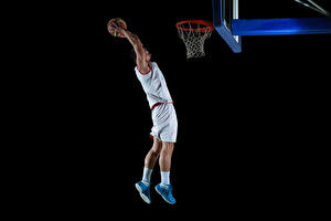 Photo Basketball Man Black background Jump Hands Ball Uniform athletic
